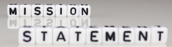 Schriftzug Mission Statement aus Buchstabenwürfel zusammengesetzt